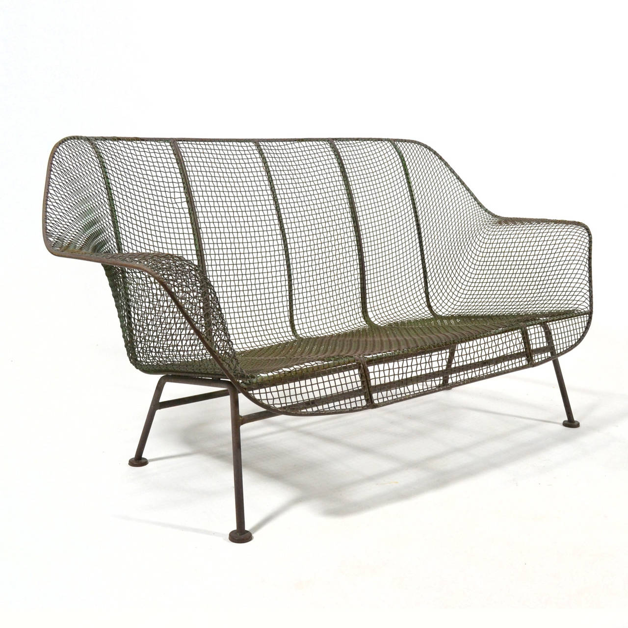 The Sculptura line by Russell Woodard is an enduring design for comfortable and long-lasting modern outdoor furniture. The wrought iron frame covered in sculpted wire mesh references the organic designs of Eames and Saarinen and parallels their