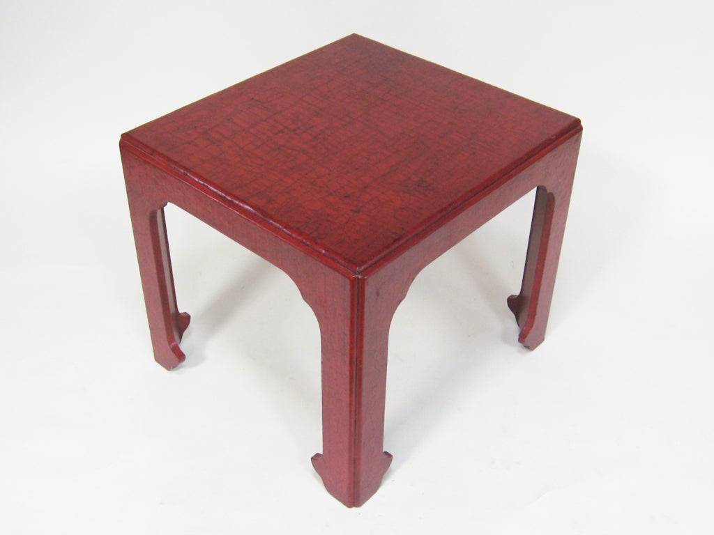 A wonderful asian style side/ end table by Baker with a craquelure finish in Chinese red lacquer.
