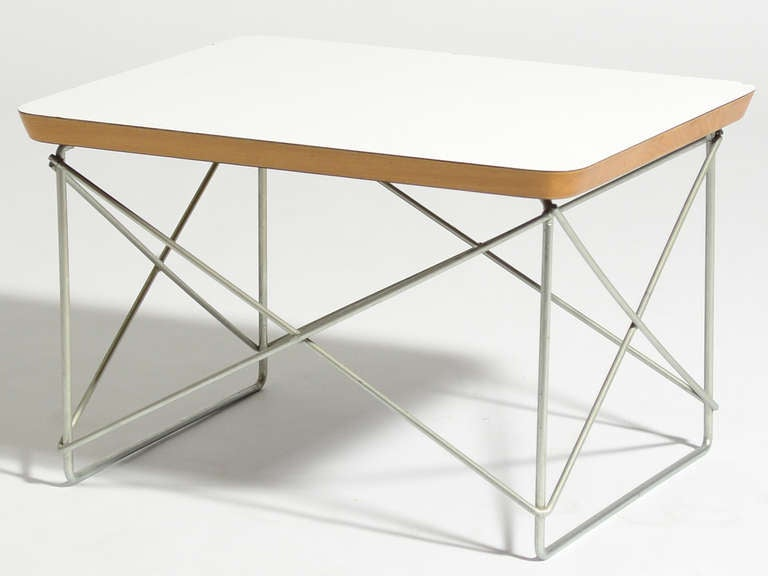 The LTR (or Low Table with Rod base) by Charles and Ray Eames is a delightful little design. A small side or occasional table with nice proportions and a lovely visual lightness due to the slender wire base. This example has the less common solid