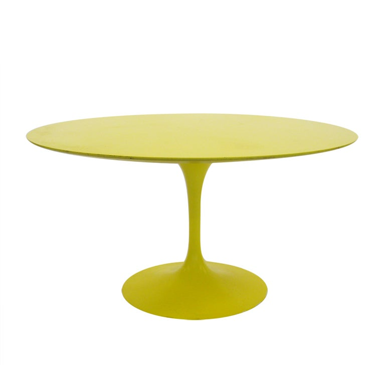 Eero Saarinen tulip table in vivid yellow by Knoll