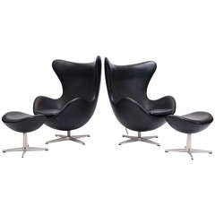 Pair of Arne Jacobsen Egg Chairs and Ottomans by Fritz Hansen