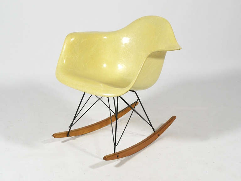 The first fiberglass Eames chairs were produced by Zenith Plastics and came in a limited palate of 5 colors including lemon yellow. The early Zenith shells are distinctive for their high fiber content and larger, more substantial rubber shock