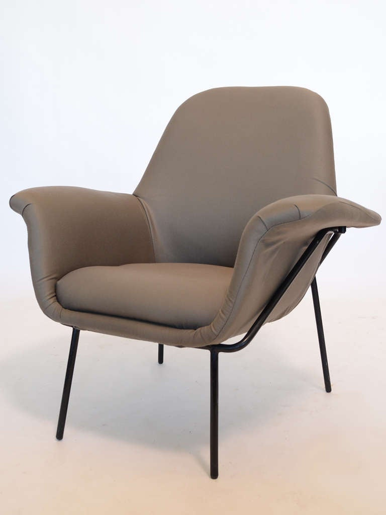 "A rare piece, this elegant and comfortable ""Lucania"" easy chair by Giancarlo De Carlo has an upholstered body supported by an iron frame. It is perfect for reading, conversing, or relaxing."