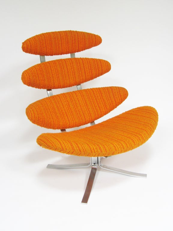 This spectacular example of an iconic design by  Poul Volther is in very good condition, still upholstered in the original textured orange wool stripe. A supremely comfortable chair, the segmented seat and back take their inspiration from the phases
