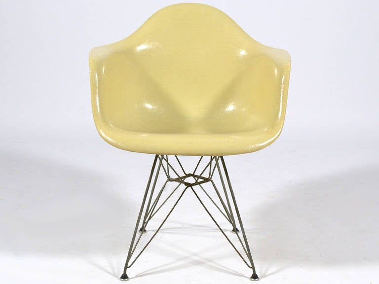 The earliest fiberglass Eames chairs were produced by Zenith Plastics and came in a limited palate of five colors including parchment. The Zenith produced shells are distinctive for their high fiber content, larger, more substantial rubber shock