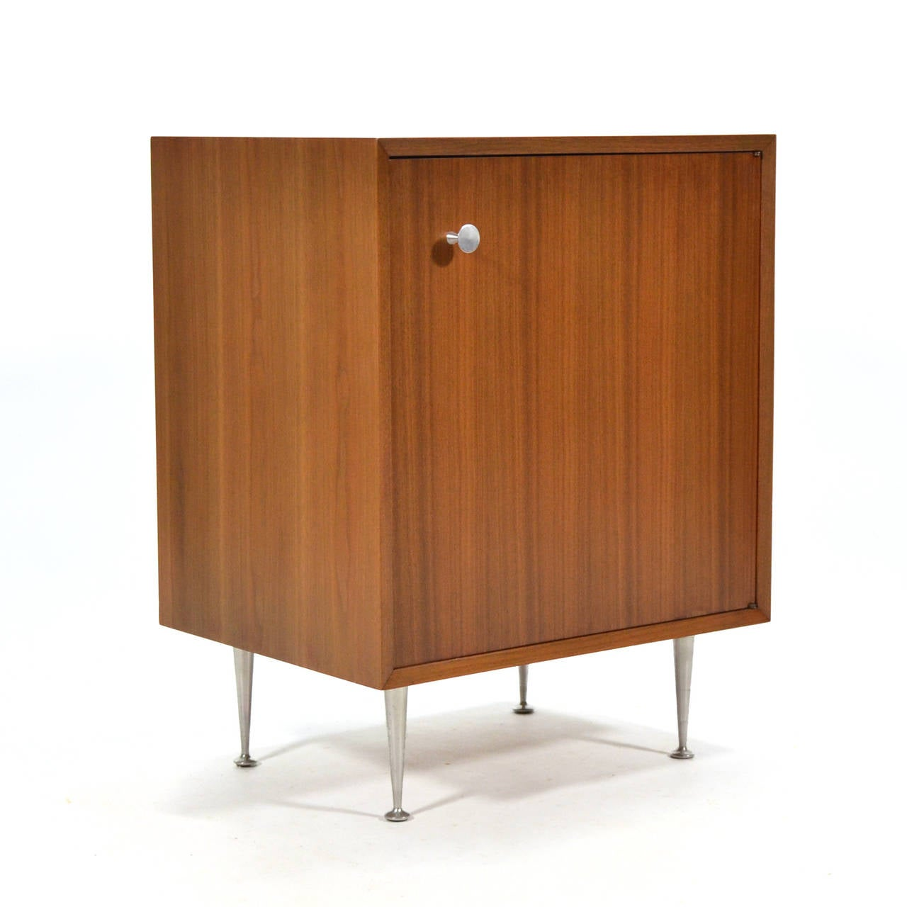 This handsome little cabinet has a terrific scale, making it the perfect occasional piece. Herman Miller offered a variety of legs and pulls for the case goods designed by Nelson. This model 4702 cabinet is from the basic cabinet series, but it has