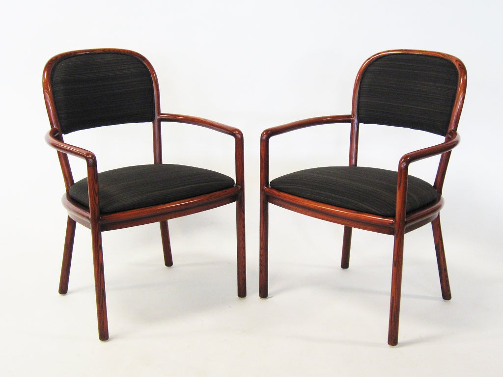 Ward Bennett's designs are understated, perfectly proportioned and impeccably constructed. This handsome pair of armchairs have been refinished and upholstered in a high quality horsehair fabric that echos the refined and rich quality of the design.