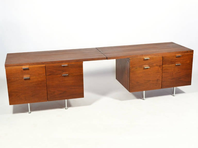 Custom fabricated for the office of the president of Grand Valley State College in Western Michigan, this pair of walnut credenzas are very versatile and offer not only loads of storage, but a substantial work surface. They each feature an extra