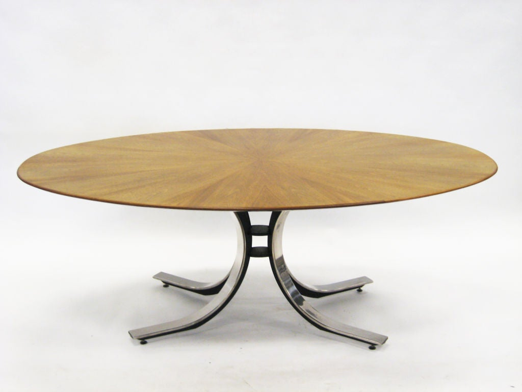 This beautiful elliptical table strikes just the right balance. The exuberant curved base and finely detailed top add just enough elegance without being fussy or flashy. The steel base is a combination of black enamel and polished chrome and the