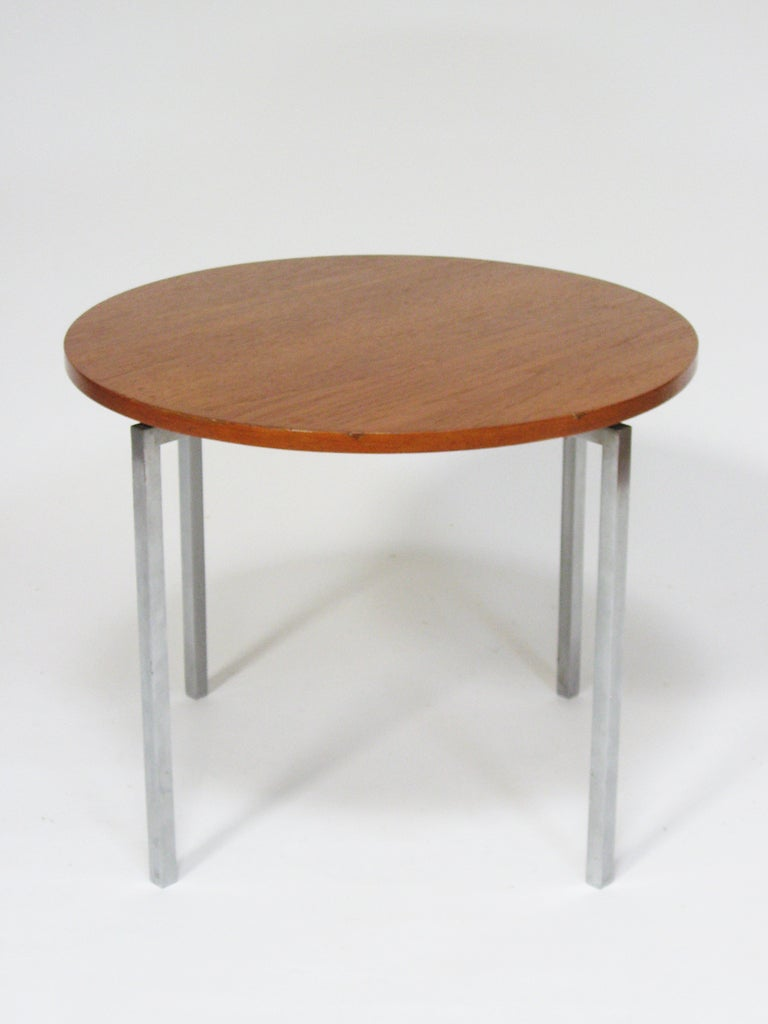 This great little table designed by Florence Knoll perfectly exhibits her highly refined design sensibility and the quality of vintage Knoll production. The round walnut top is supported by a solid steel base with a brushed nickel finish. There is a