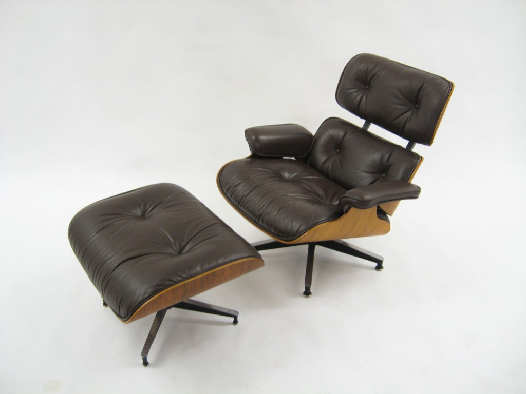 This Eames 670 lounge chair and ottoman from 1977 is in near-mint condition having just been purchased from the original owner. The original chocolate brown leather is in excellent condition and a nice variation from the classic black leather.