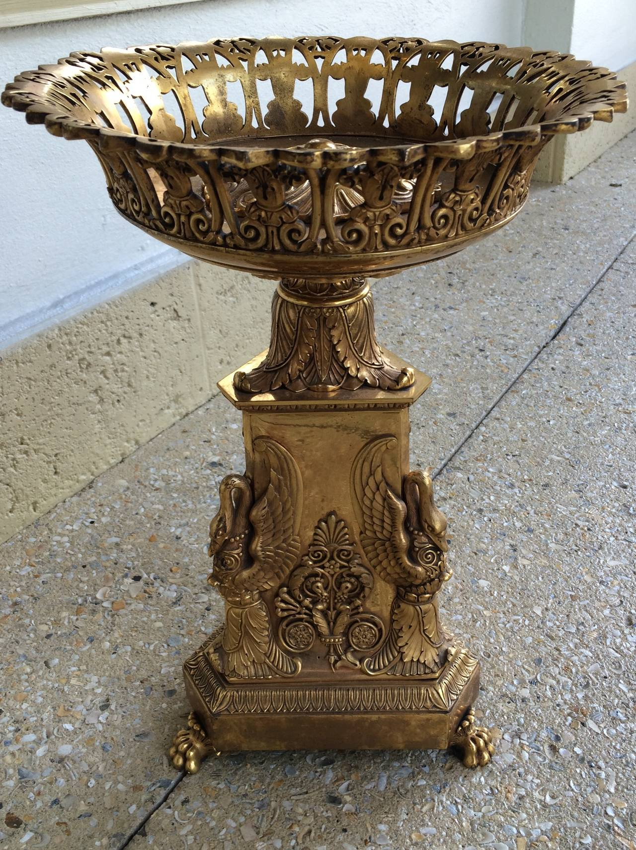 Charles X bronze doré centerpiece with decorative mounts including swans, acanthus leaf, and claw footed base, circa 1820-1830.