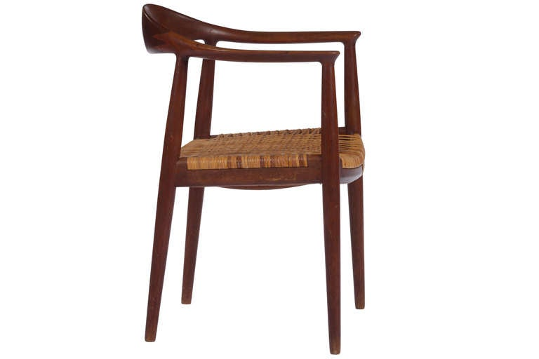 Iconic Hans Wegner Classic chair manufactured by Johannes Hansen in teak with caned seat.