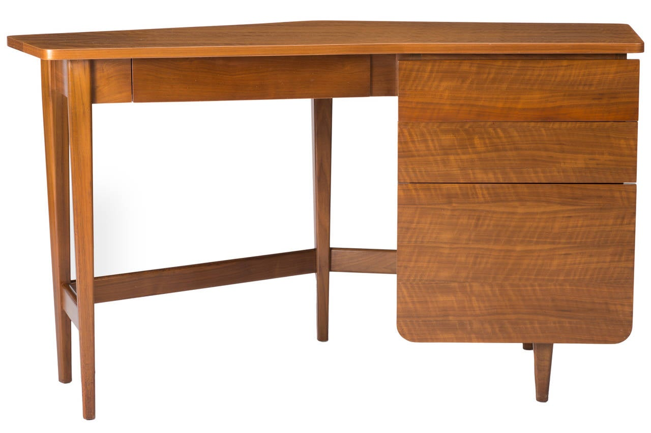 A rare angled desk designed by Bertha Schaefer in collaboration with Gio Ponti for Singer and Sons. Added lock to bottom drawer, key included.