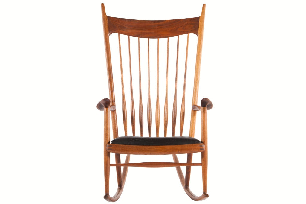 Beautiful and iconic rocker from noted California woodworker Sam Maloof. Spindled back, fine joinery details and leather seat. Signed with branded mark to underside of chair.