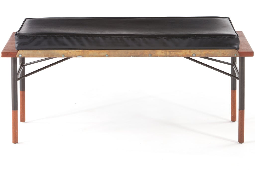 Finn Juhl designed table or bench manufactured by Bovirke, Denmark. Teak top, brass rails and enameled steel legs with teak wooden tips to bottom. Bench includes original cushion.