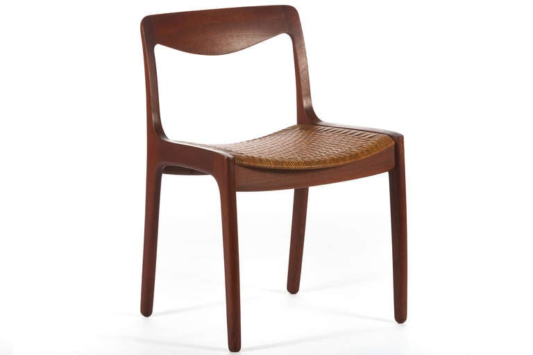 Beautiful set of 12 dining teak dining chairs designed by Vilhelm Wohlert and manufactured by P jeppesen of denmark and retailed by Illums Bolighus. Teak frames with perfectly patinated caned seats.