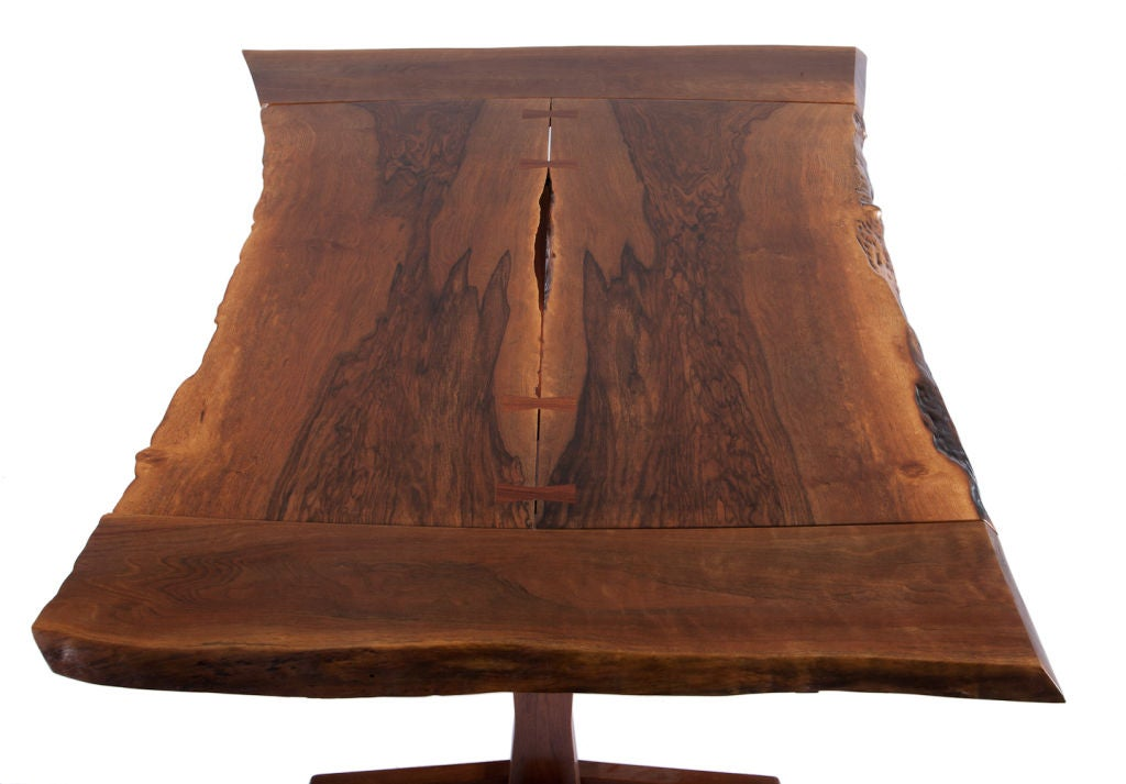 Beautiful George Nakashima dining table with finely grained, bookmatched free edge Persian walnut top with four rosewood butterflies, with two 12-inch leaves. Table has full provenance with copy of original drawing and receipt.