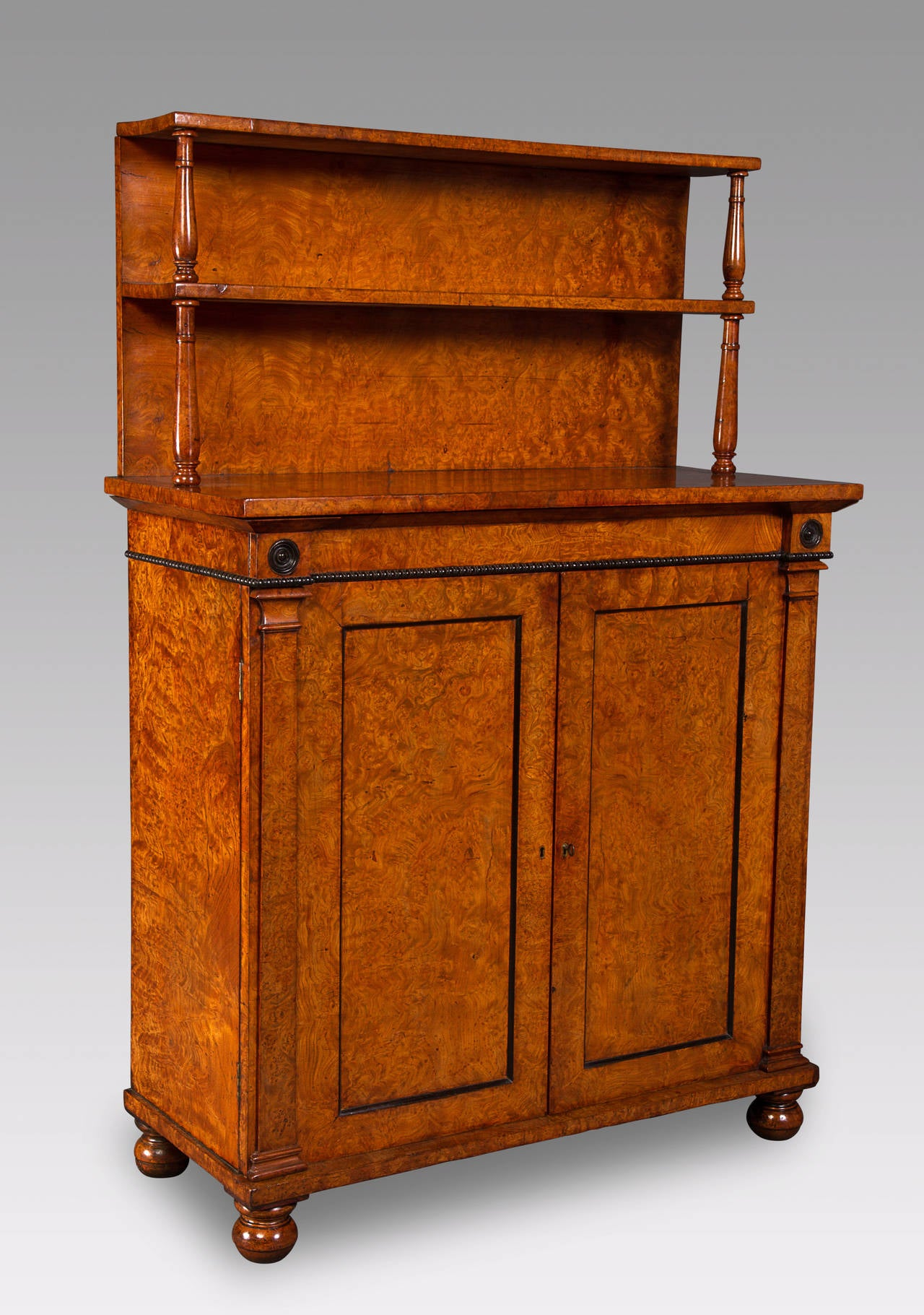 The late 18th and early 19th century saw the re-emerging use of indigenous timbers in the construction for fine British furniture with George Bullock in England and William Trotters in Edinburgh, Scottland being the most prominent proponents of