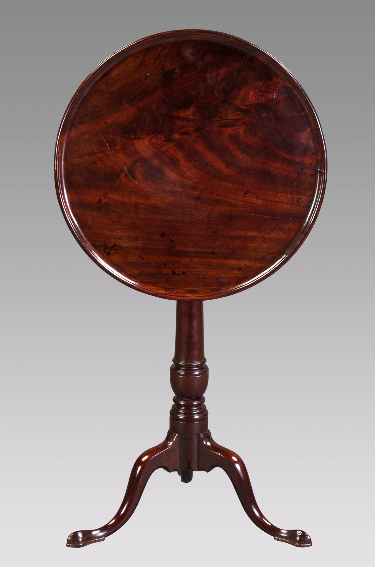 This superbly designed table from the earliest years of George II, c. 1730 is of the very finest Cuban or Santo Domingo mahogany, prized for its extreme density, tight grain and magnificent rich color and graining. A simple design, perfectly