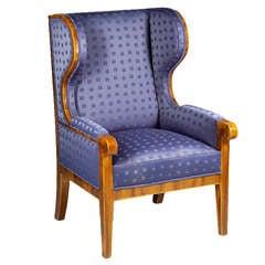 A petite Biedermeier Fireside armchair