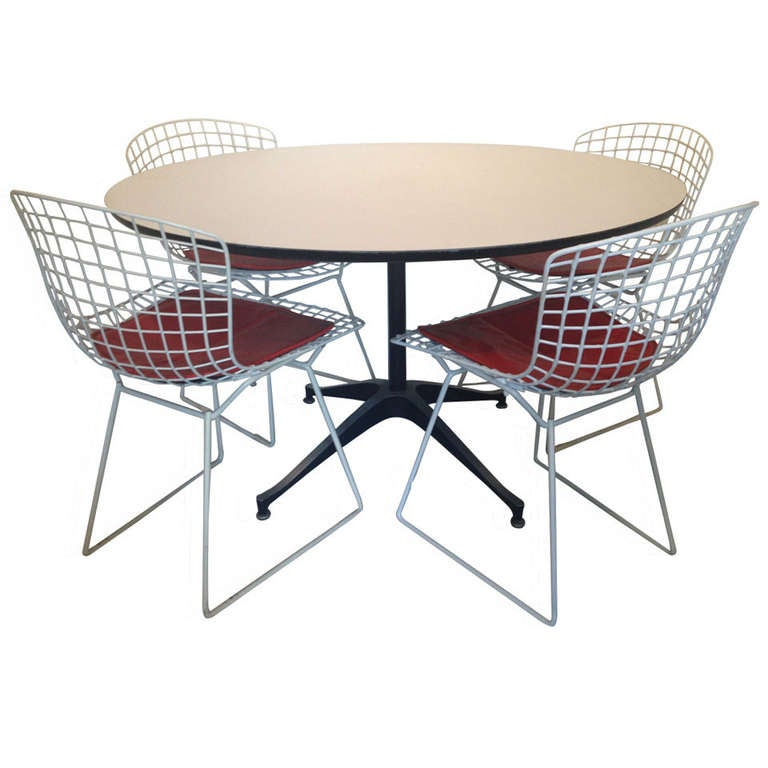 dining set of four harry bertoia chairs and danish formica table at