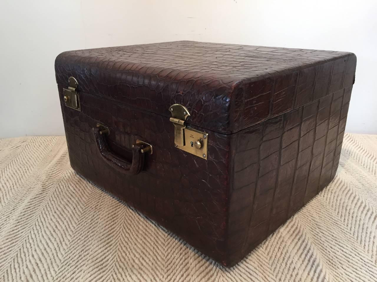 English brown alligator brass lock hardware large travel trunk, with all original lining.