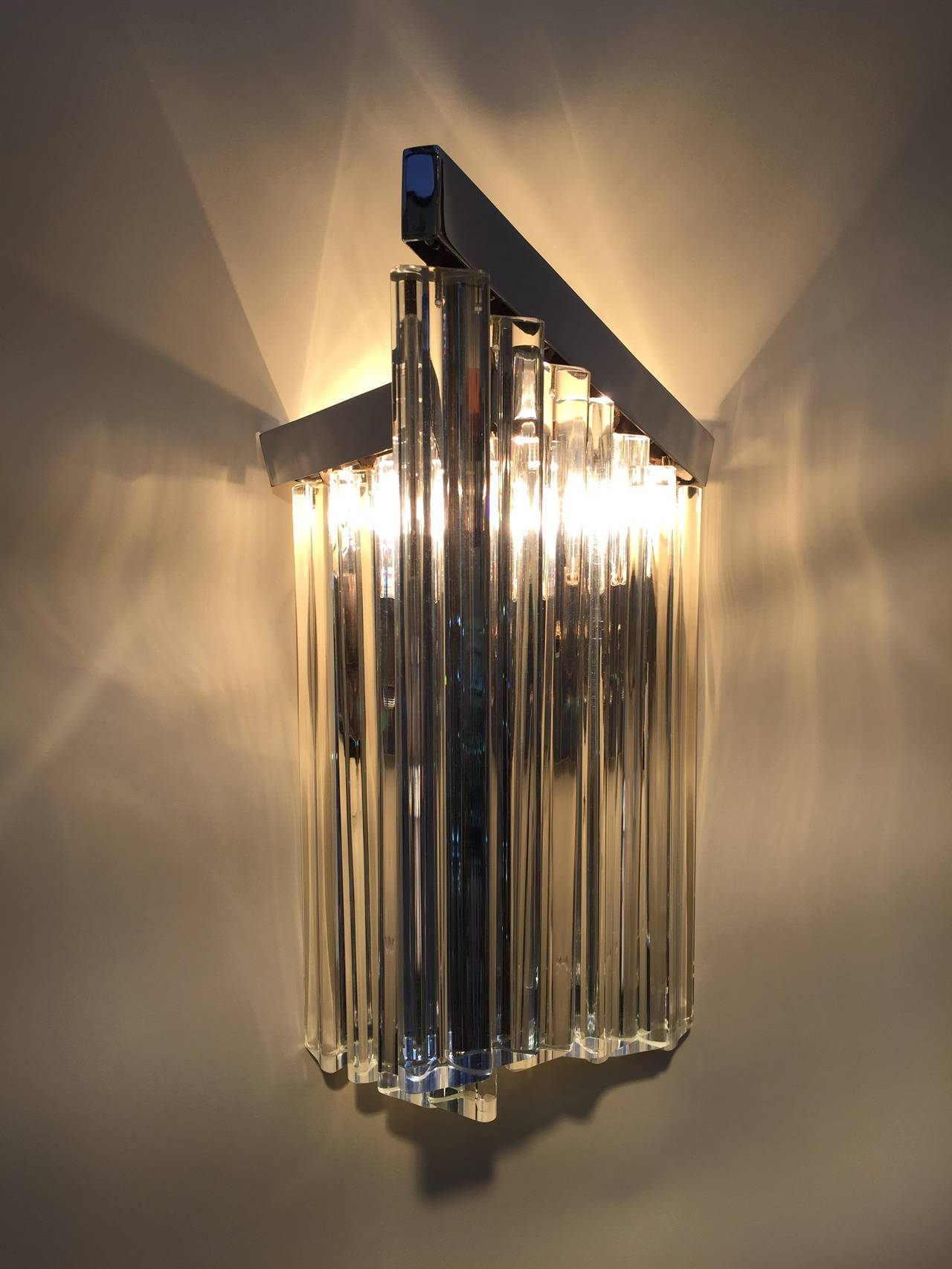 Pair of glass rod and polished chrome sconces, stamped Murano.