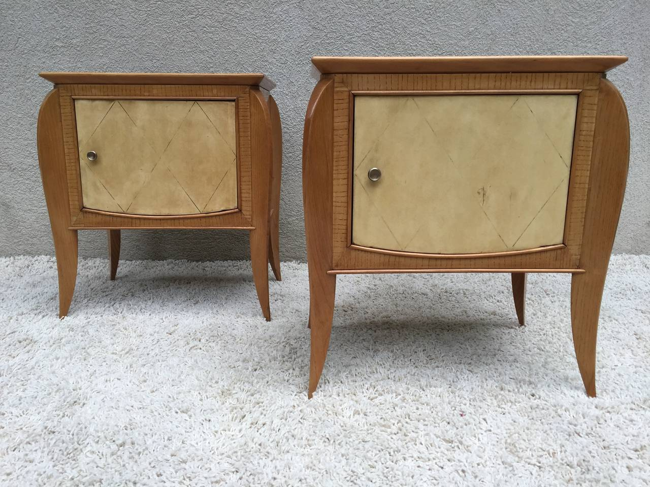 Pair of French petite parchment sycamore or zebra wood nightstands or end tables. Lovely bronze pulls, with cabinet compartment. In the style of Jules Leleu.