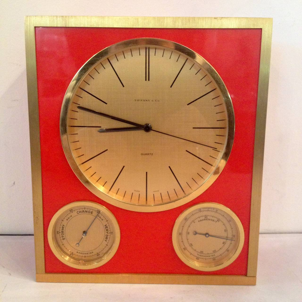 Tiffany and Company orange glass and brass clock barometer, thermometer, rare. Mid-Century design.