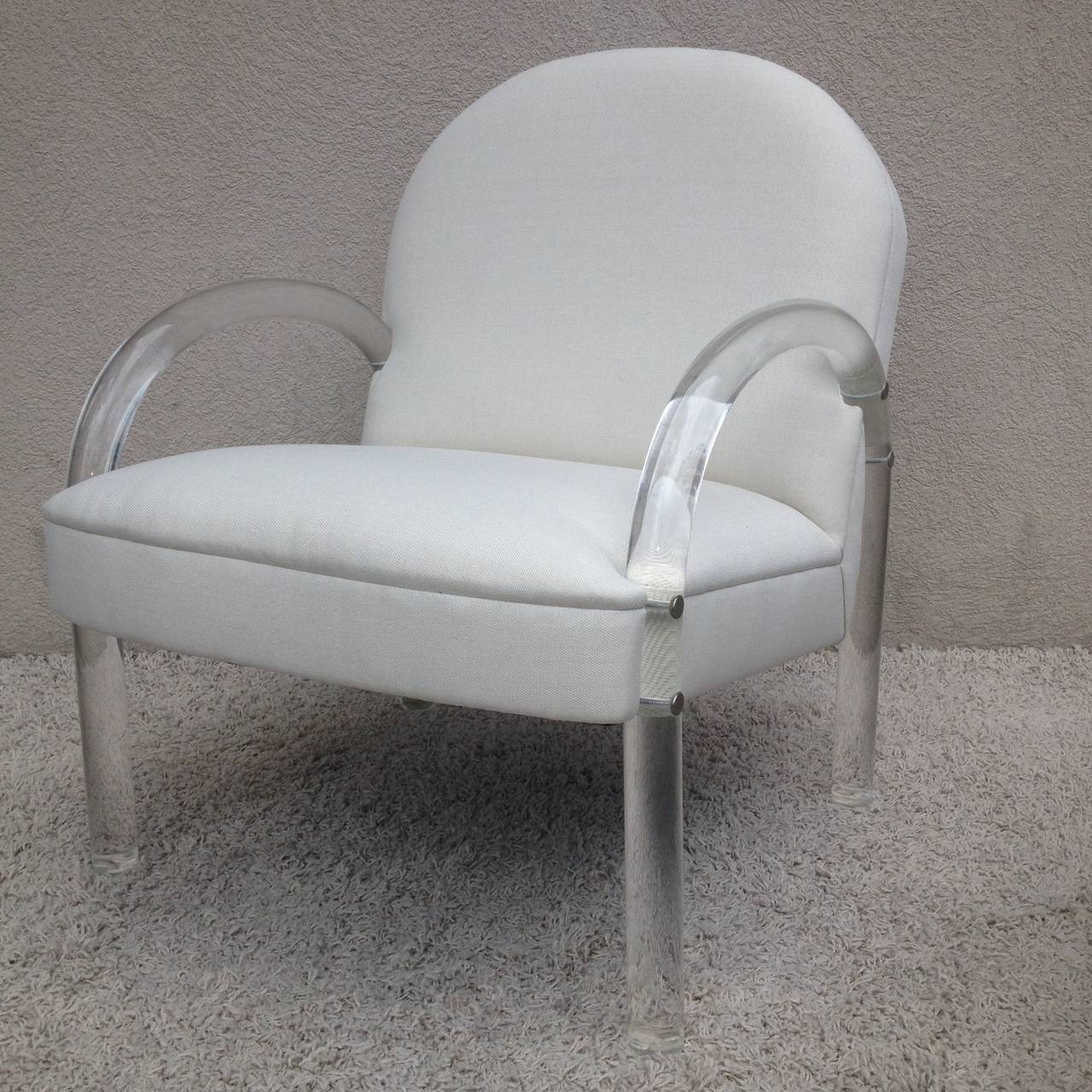 Pair of Charles Hollis Jones Lucite club chairs in off-white weaved fabric.