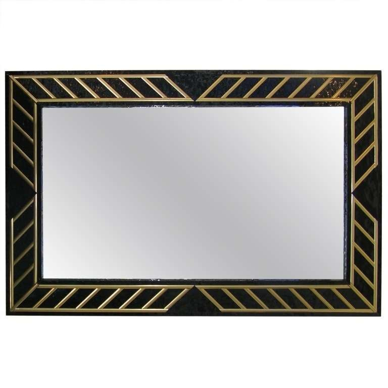 Late 1970s very elegant pair of custom-made black glass mirrors with dramatic design, decorated with gilt wood inserts and the surround enhanced by a special textured black glass, vetro bugnato.  Also the sides are covered in the special textured