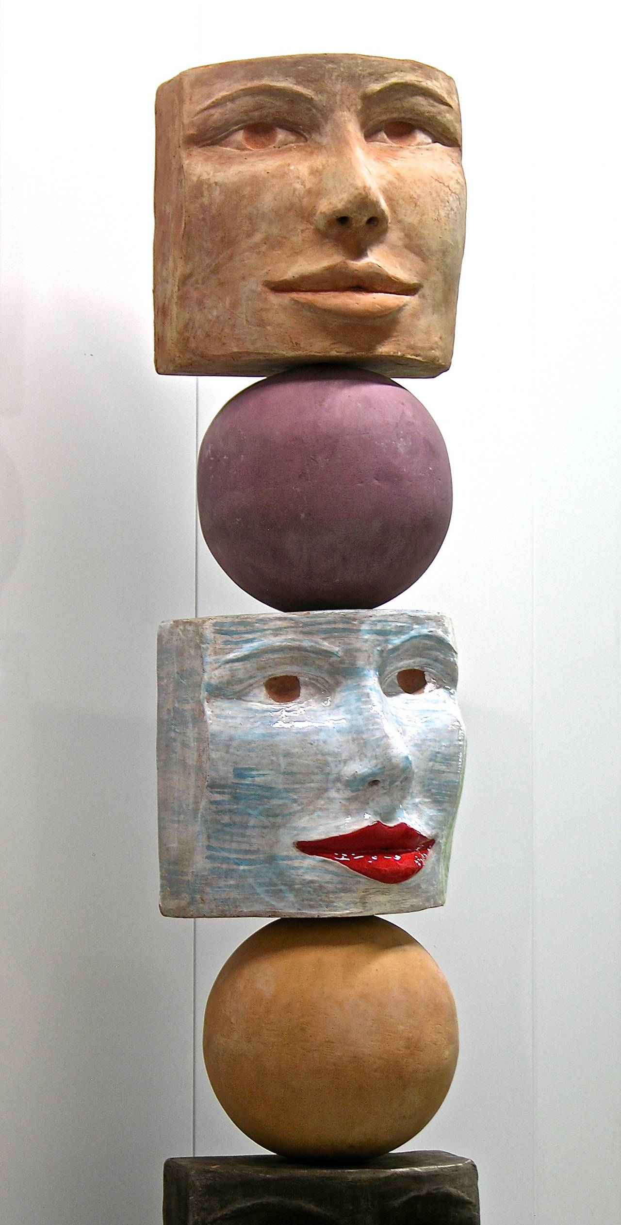 A contemporary Work of Art by the Italian artist Ginestroni. Entirely handmade and sculpted in brown and gray anthracite terra cotta. Two of the five head sculptures have been fired enameled in a unique sky blue and caramel brown glossy look with