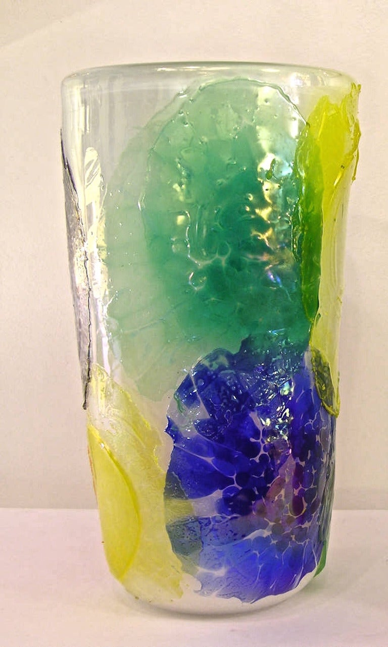 1960s Italian vase in a thick high quality overlaid Murano glass, the technique of the decoration quite unique: The exterior is coated with colorful overlapping paper thin glass disks, the glass so thin that it crunches and pulls during the