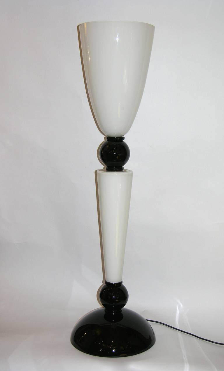 Late 1970s elegant, tall and slim pair of black and white lamps, very attractive visual line, sophisticated blown glass with high quality interior and exterior overlays with rounded edges, having very chic black accents. Their size makes then
