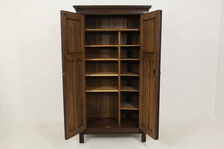 Tudor Style Linen Fold Oak Armoire In Excellent Condition For Sale In Vancouver, BC