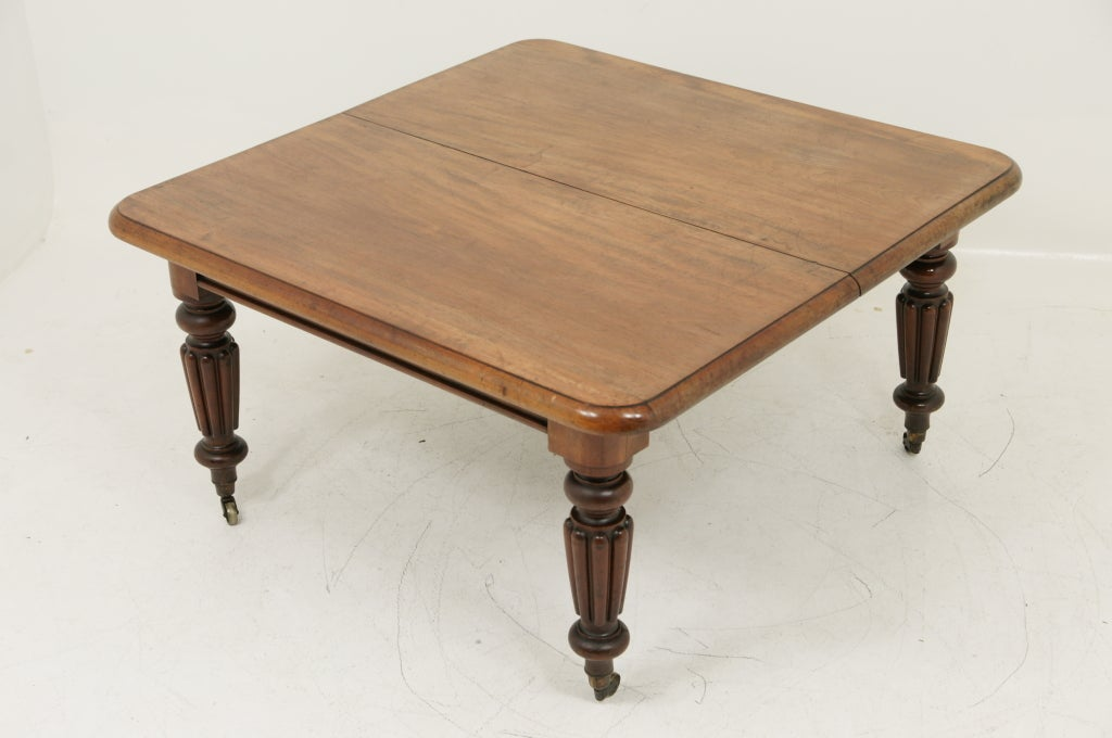 19th Century Victorian Mahogany Dining Table and Two (2) Leaves