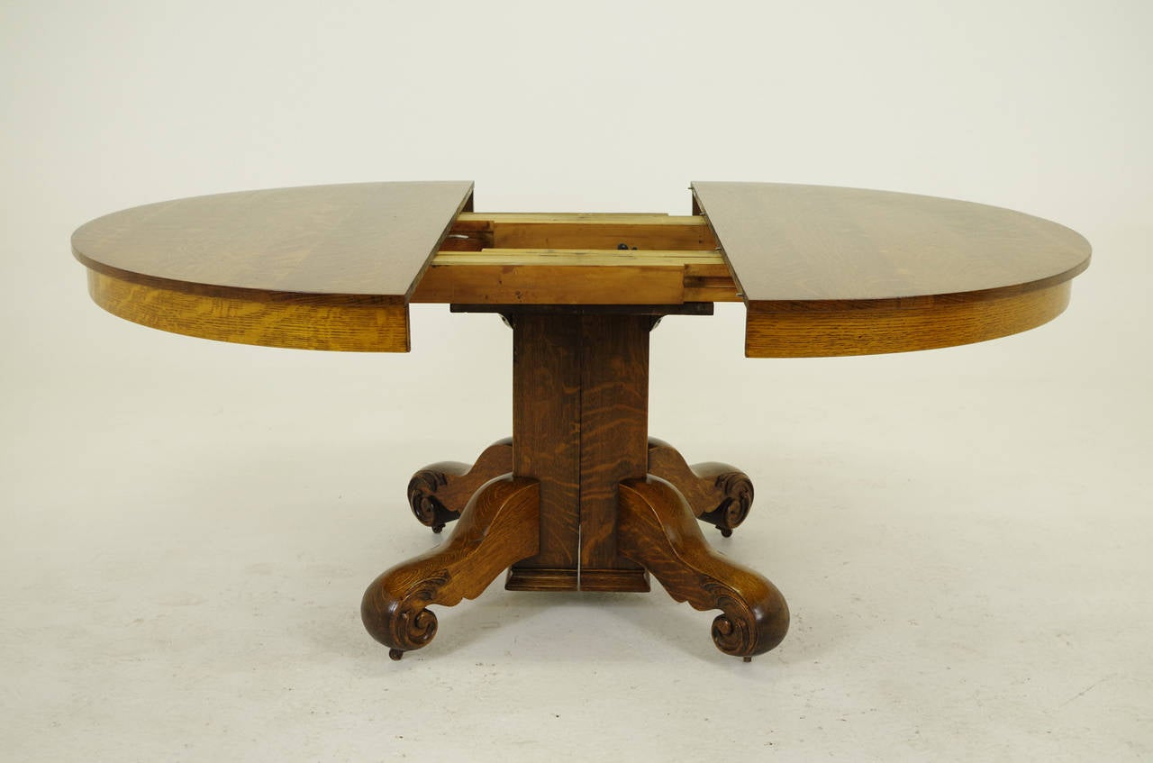 Round oak split pedestal dining table with four leaves for Round pedestal table with leaf