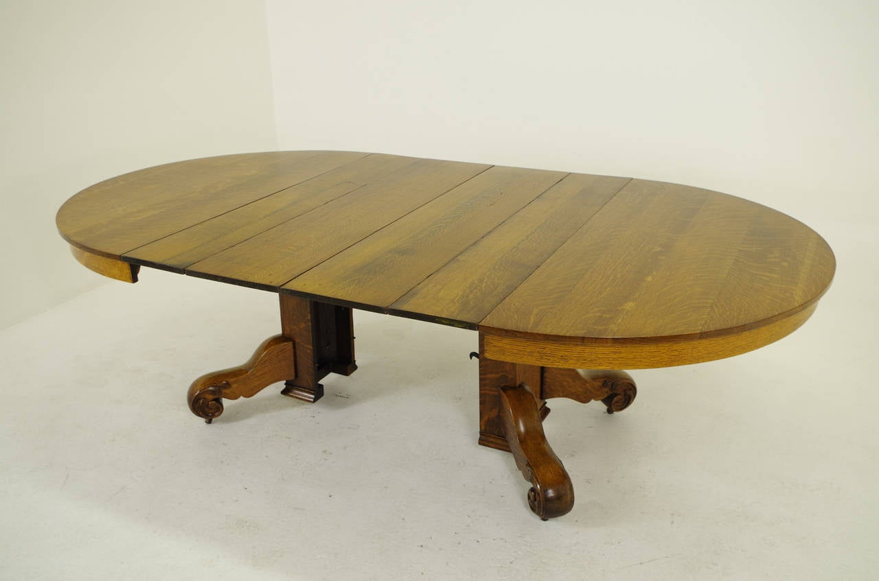 Round Oak Split Pedestal Dining Table With Four Leaves 1910 At . Full resolution  img, nominally Width 1280 Height 847 pixels, img with #653E17.