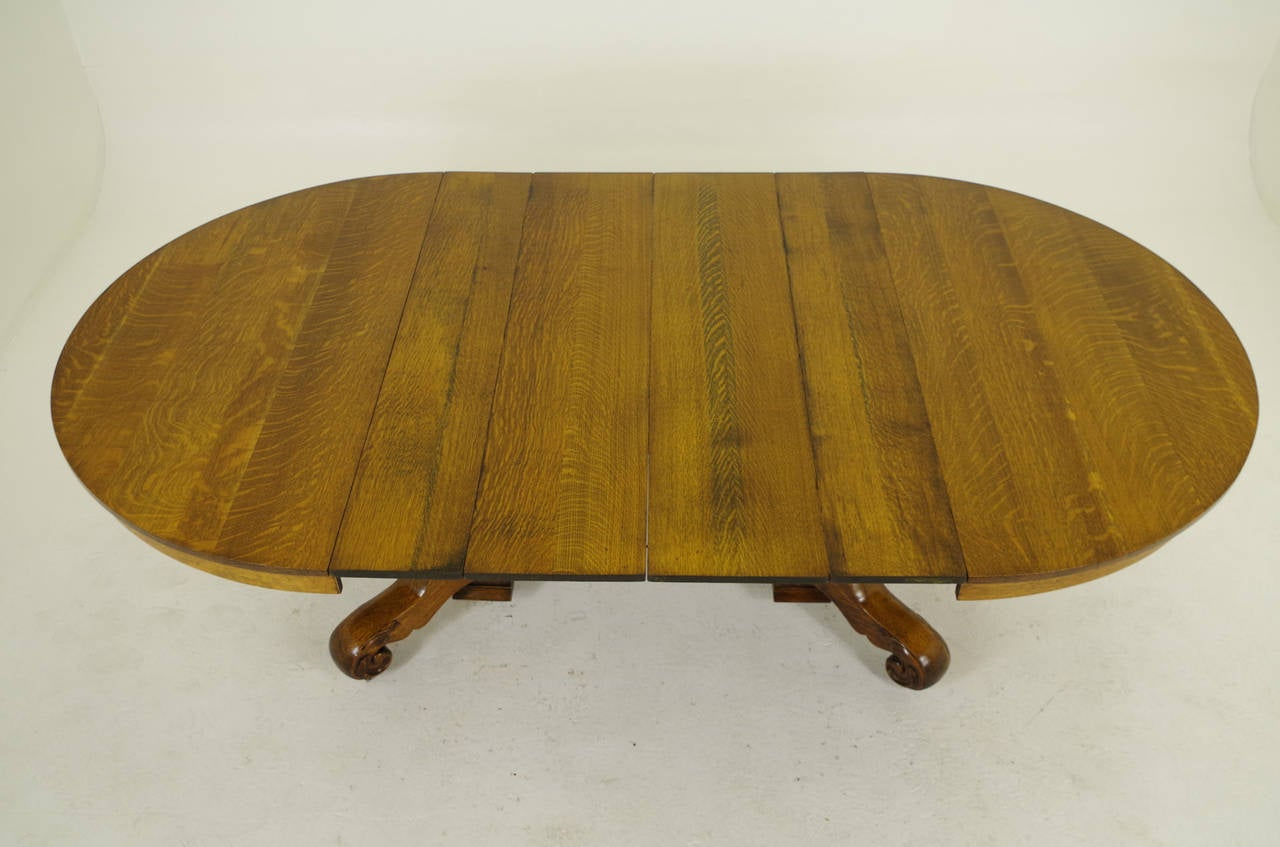 Round Oak Split Pedestal Dining Table With Four Leaves 1910 At . Full resolution  img, nominally Width 1280 Height 847 pixels, img with #724C16.