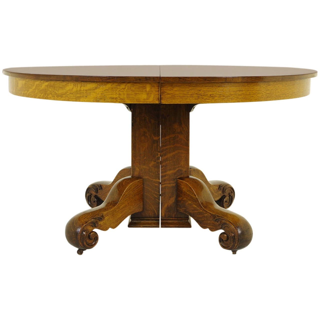 Oak Pedestal Table ~ Round oak split pedestal dining table with four leaves
