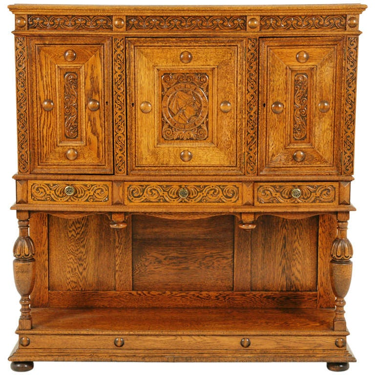 Heavily carved oak three door carved oak cabinet buffet for Carved kitchen cabinets
