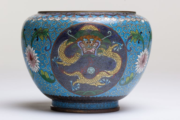 Chinese cloisonne bronze urn with dragon and floral motifs intricately crafted in beautiful shades of turquoise, indigo, pink, yellow, green and red c. 1890.
