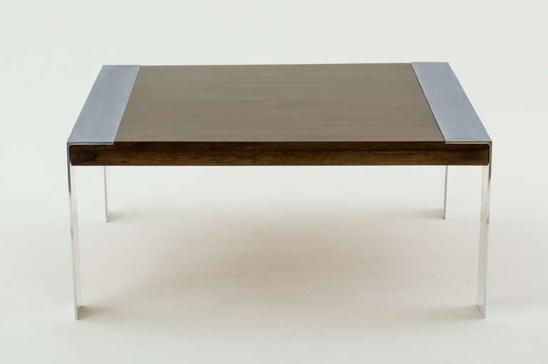 Square Milo Baughman style walnut coffee table has flat bar chromed steel legs and frame.
