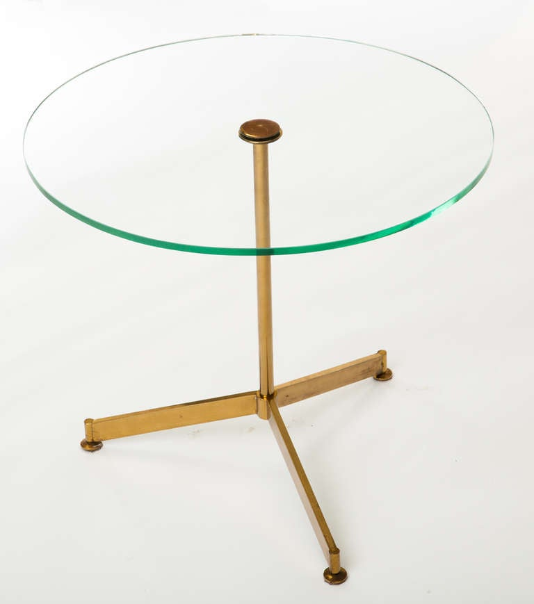 Circular glass occasional table with tripod brass base, Italy, 1960s.