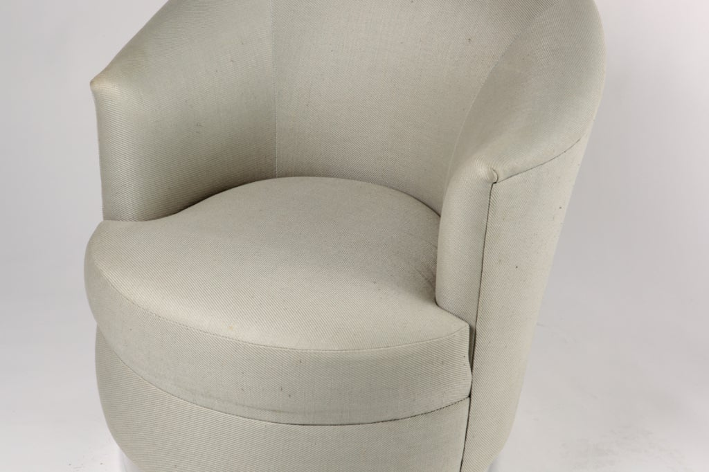 Karl Springer swivel club chairs with original wool or linen upholstery and brushed steel circular bases. From a Lake Shore Drive , Chicago estate.