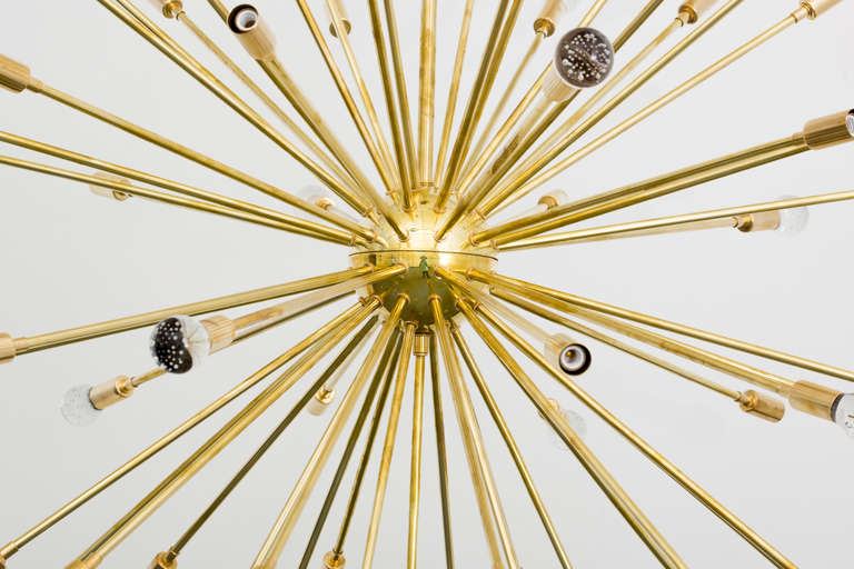Spectacular brass sixty-one-arm Sputnik chandelier with inclused glass orbs and 30 light sockets. Overall height 51