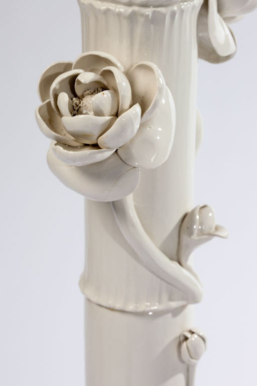 Italian ceramic faux bamboo and lotus flower floor lamp, with lily pad base..  Lotus blossoms encircle the lamp column as if growing up from the base. Italy, circa 1960s.