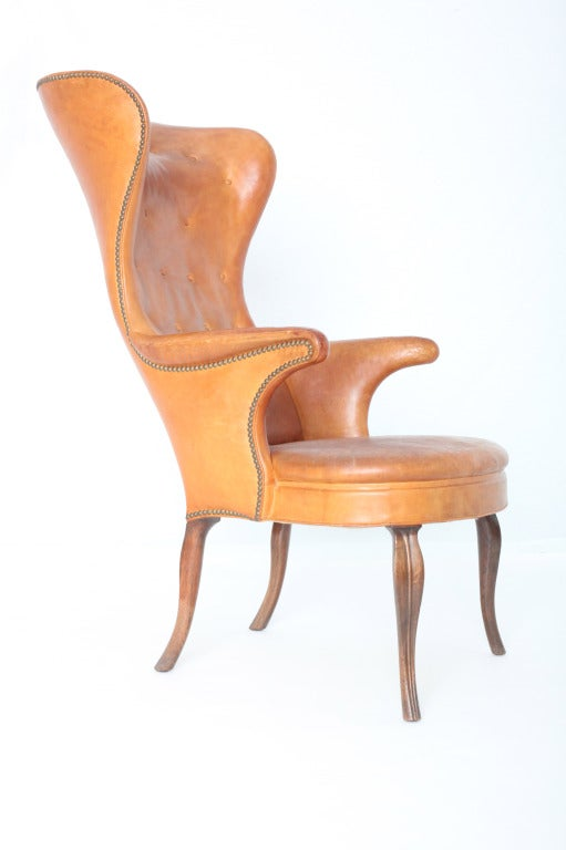 It was love at first sight… the unforgettable silhouette, the gorgeous leather aged perfectly, highlighting the rich patina…We knew immediately that we had to have it in our collection, the High Wingback chair is considered to be Frits Henningsen's