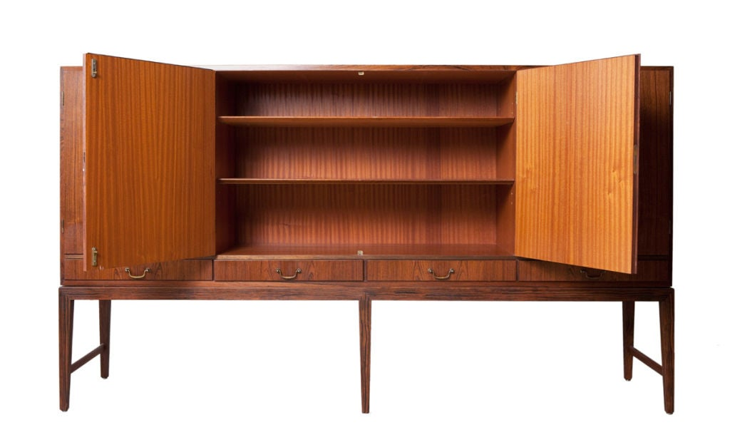 Severin Hansen Jr. rosewood sideboard Like many Hanson Jr. designs this sideboard has the hallmark features of many of his works as seen in the delicately tapered legs of this serving piece. Mid century Danish modern designers found inspiration in